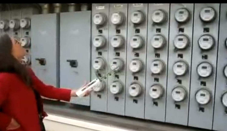 """Stop Smart Meters! volunteers measuring the radiation from a bank of 80 PG&E """"smart"""" meters in Berkeley, CA"""