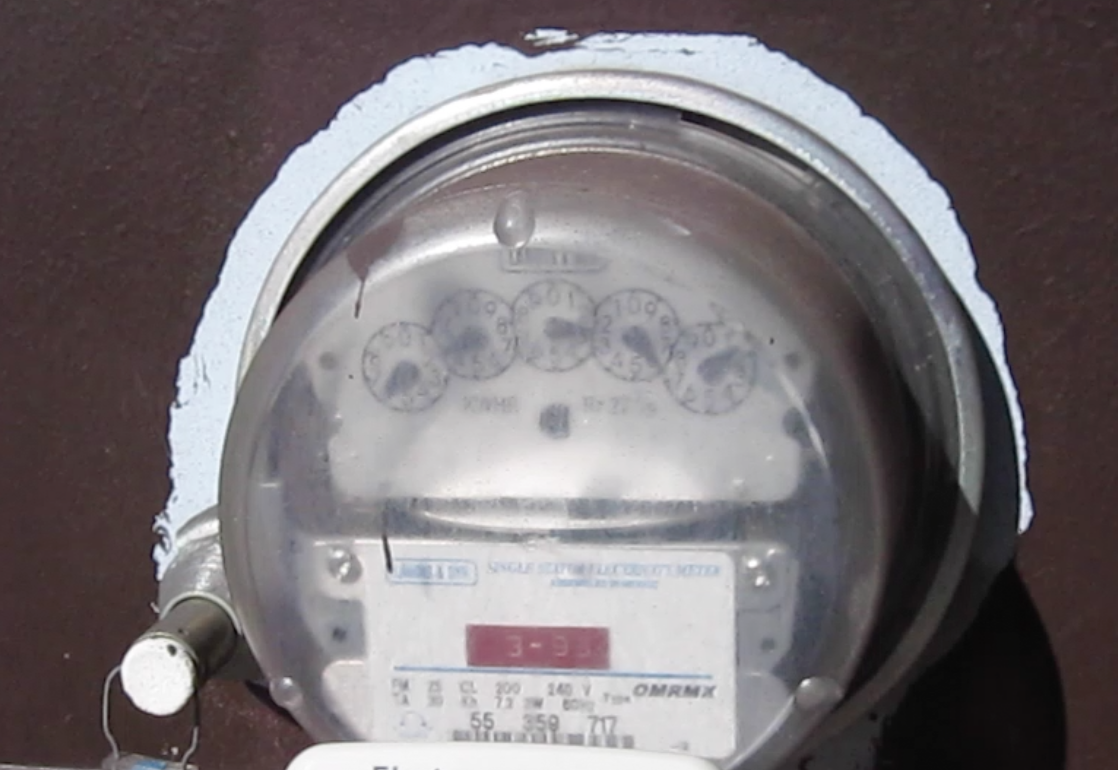 """This Landis & Gyr meter used by PSREC looks like an analog but """"wakes up"""" and transmits the electrical readings using microwave signals when it receives a signal from a meter reader once a month. Because it has electronic components, this is also a """"smart"""" meter"""