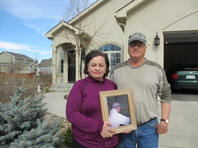 Craig and Virginia Farver stand outside their Fort Collins, CO home where their municipal utility forced a smart meter on their home, backed by police 3 weeks ago