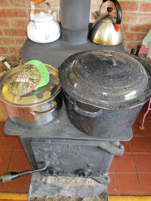 large pots of water on the stove can retain heat in the room and provide available water for washing dishes and bathing