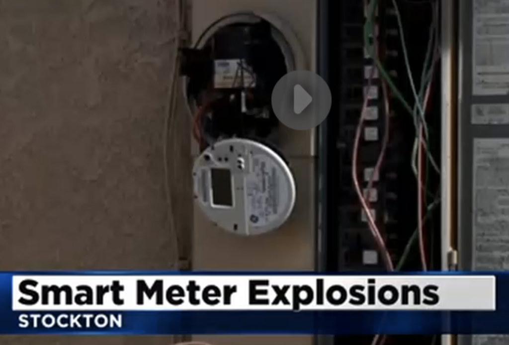 A smart meter face is left dangling in Stockton after numerous meters explode or catch of fire after a surge.